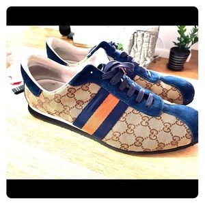 Gucci sneakers with blue and orange accents.